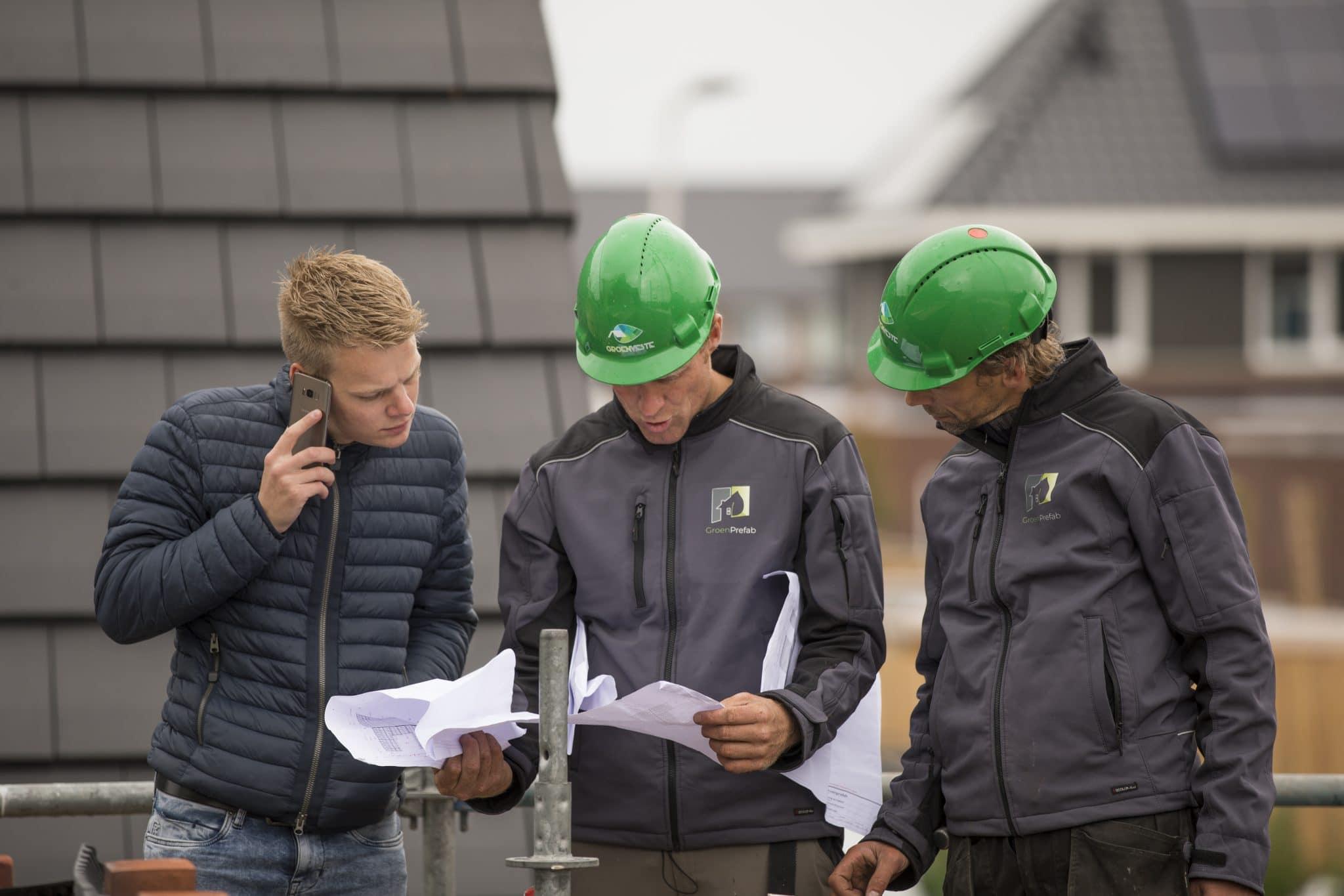 Overleg op de bouw